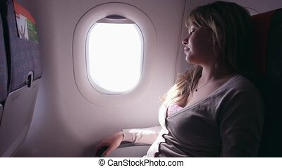 People, woman traveling on plane - People, travel and fear,...