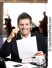 Signing contract - Satisfied businessman signs a contract in...