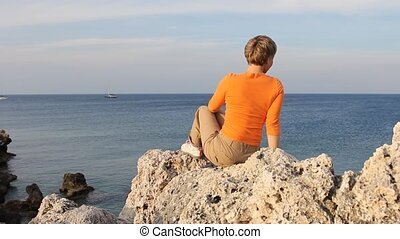 Woman Relaxing on the Ocean Beach i