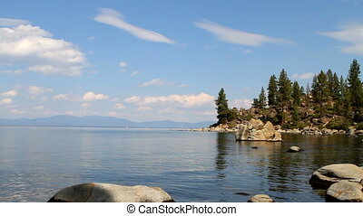 Lake Tahoe Cove - Large rocks line the shore of a small cove...