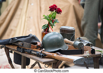 world war 2 equipment - rifle, hand grenade uniform and rose