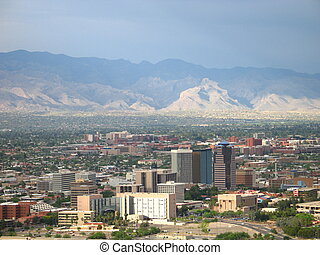 TUCSON, ARIZONA - DOWNTOWN TUCSON, ARIZONA WITH MOUNTAINS IN...