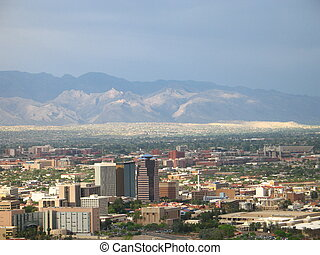 TUCSON , ARIZONA WITH MOUNTAIN RANGE LIT UP