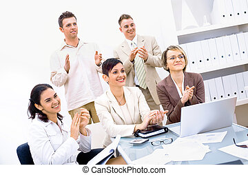 Business team clapping - Group of five happy business people...