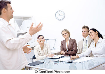 Business vision - Businessman standing and explaining to...