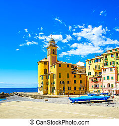 Camogli church on sea, boats and beach view. Liguria, Italy...