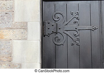 decorative hinge - dark wood and decorative hinge on door of...