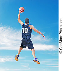 clouds and dunk - basketball player dunking in a cloudy sky