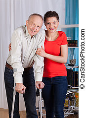 Disabled man with nurse - Disabled man standing with his...