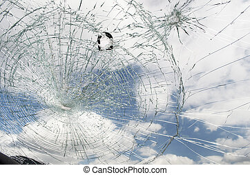 Shattered Windshield - Shattered windshield with blue sky...