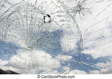 Shattered Windshield - Shattered windshield with blue sky...