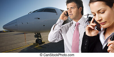 Businesspeople and corporate jet - Very busy young...