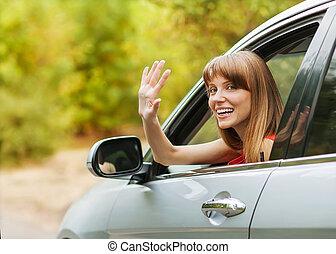 Caucasian car driver woman smiling