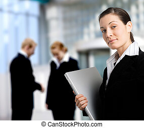 Business Lifestyle - Business people stand in front of an...