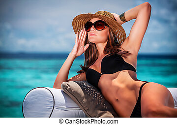 Summer vacation concept - Portrait of sexy model posing on...