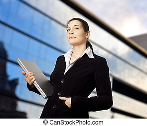 Sucessful Businesswoman - Businesswoman holds a modern...