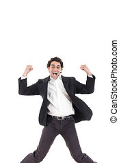 Young happy business man jumping in the air with legs...