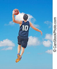 dunk among the clouds - basketball player dunking in the sky