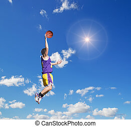 dunk in the sky with sun - basketball player dunking in the...