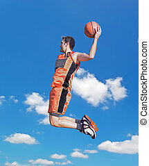 dunk in the sky - basketball player dunking with the sky in...