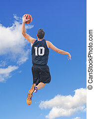 dunk and sky - basketball player dunking in the sky