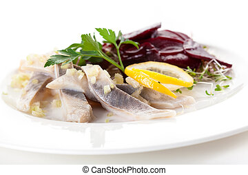 Mix of herring beets and sprouts on white plate