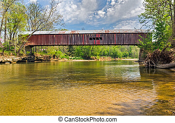 Cox Ford Covered Bridge, built in 1913, crosses Sugar Creek...