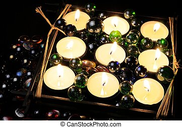 Burning Candles with Glass Stones in the Dark - Nine burning...