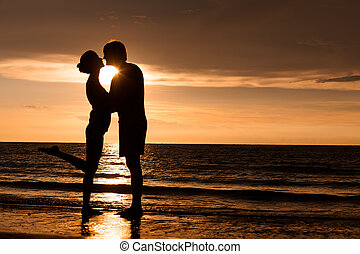 silhouette of two people in love at sunset