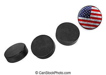 American hockey pucks lined up in a row on white background
