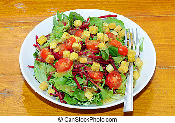 Salad dish - Green salad dish with tomatoes and croutons