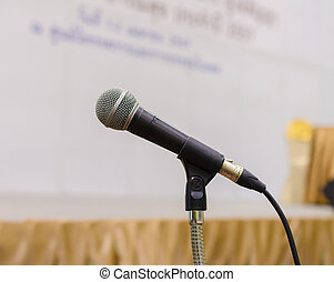 Close up of microphone in conference hall