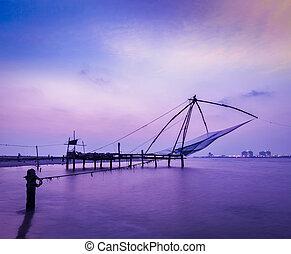 Chinese fishnets on sunset Kochi, Kerala, India - Kochi...
