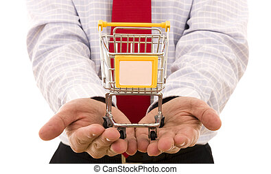 Shopping Concept - Hand holding a trolley shop (put your...
