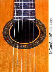 sound hole of classical acoustic guitar with six nylon...