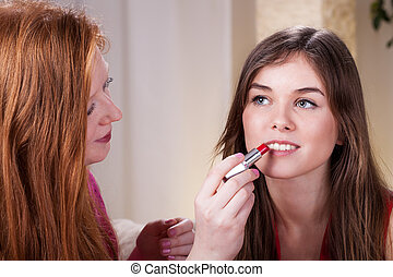 Friends doing make-up - Beautiful young girls friends doing...