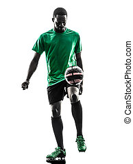 african man soccer player juggling silhouette - one african...