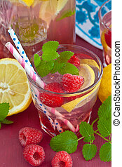 Homemade lemonade with raspberries and organic lemons