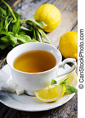 Cup of Tea - Cup of tea with mint and lemon slices.