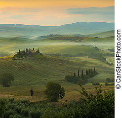 Sunrise in Tuscany - Sunrise in a misty valley in San...