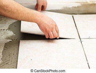 Tiling Works - Handyman doing tiling works in kitchen.