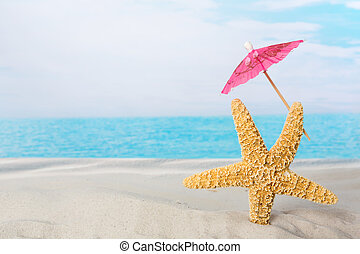 Starfish on beach with parasol - Funny starfish holding a...