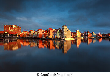 colorful buildings on water at sunrise, Groningen,...