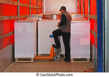 Loading truck - Loading goods in lorry truck with pallet...