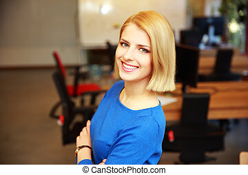 Portrait of a young smiling woman in office
