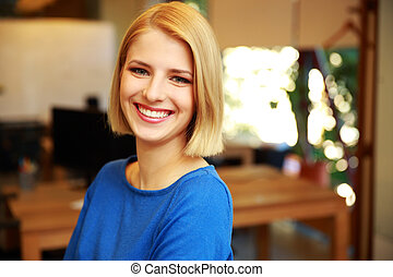 Portrait of a cheerful blonde woman