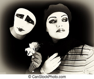 mimes with a flower - Portrait of two mimes on a black...