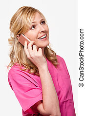 Nurse talking on phone - Female attractive blond smiling...