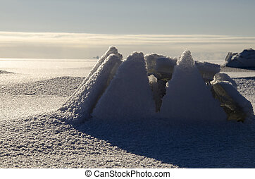 Ice House - Ice around the stone on the Baltic Sea