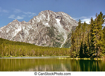 Mt Moran, in the Teton Mountain Range of Wyoming, reflected...